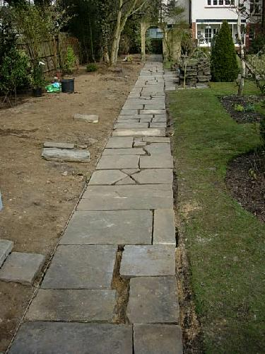 The paving slabs re-laid before infilling with sand and cement